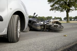 Car hitting motorcycle