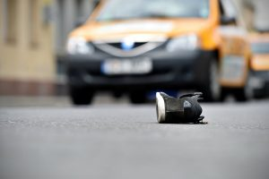 Shoe in road