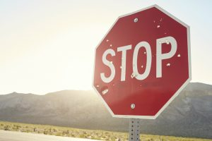 stop sign in front of cameras
