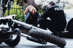 Officer at motorcycle accident