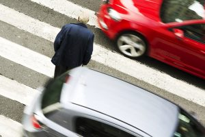 old man in dangerous situation in crosswalk with traffic lights in street city