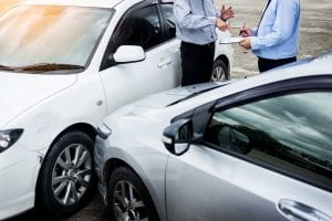 Man Talks with Insurance Agent After a Car Crash