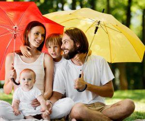 Family under umbrellas