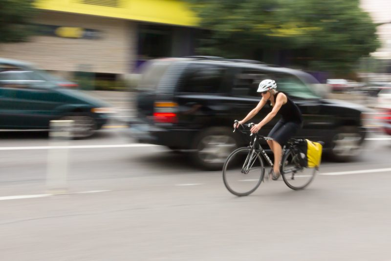 bicycle rider travels against traffic