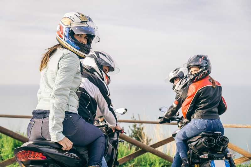 motorcycles carrying passengers