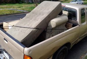 Poorly Secured Load in Truck Bed