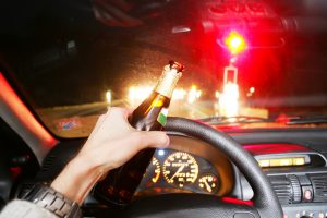 Driving while holding a beer bottle