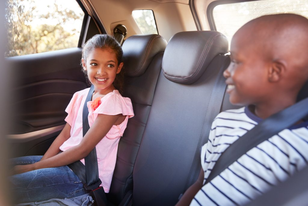 Children buckled up in rear seat of a car
