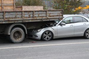 car runs under truck